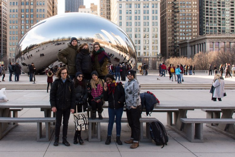Students pose in front of the Bean in Chicago.